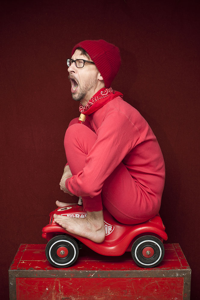 funny creative portrait red car